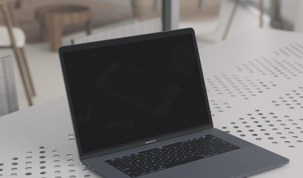 Free-MacBook-Pro-Mockup-on-Table