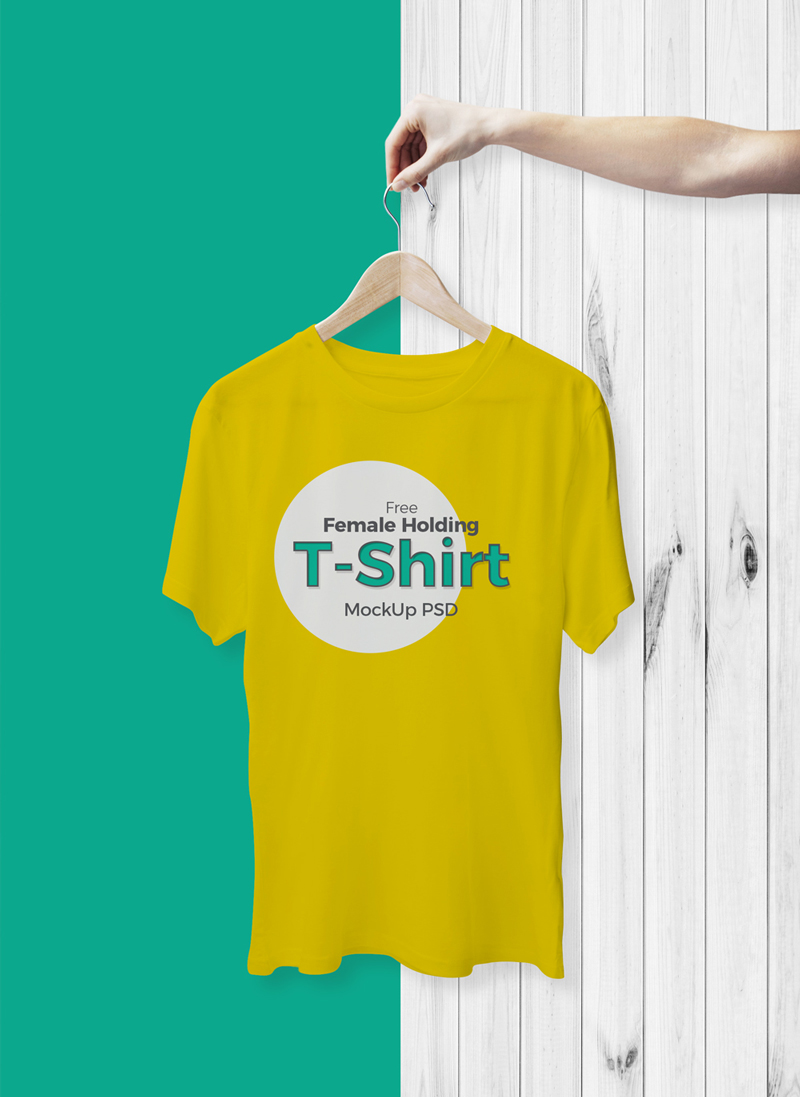 Free-Female-Holding-With-Hanger-T-Shirt-Mockup-PSD