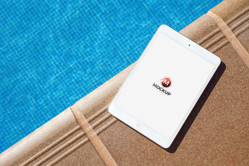 Ipad mockup beside swimming pool mockup planet for Dropped iphone in swimming pool