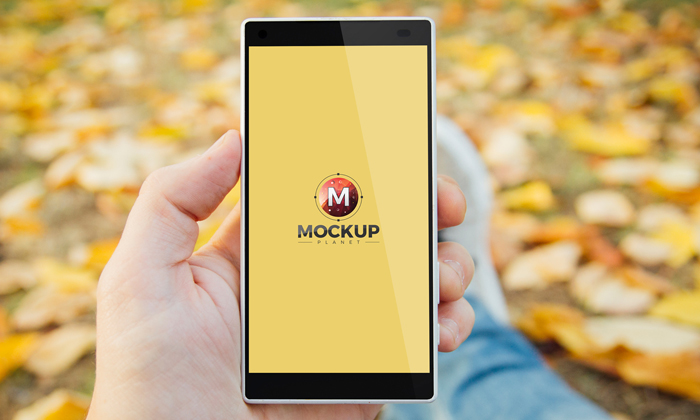 Man-in-Park-Holding-Smartphone-Mockup-Free-Psd