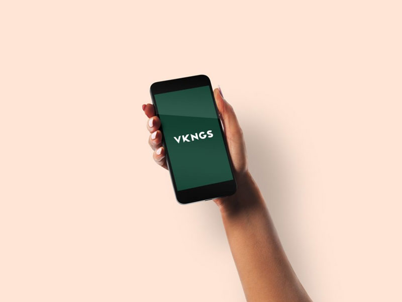Free-Female-Hand-holding-black-iPhone-Mockup-600