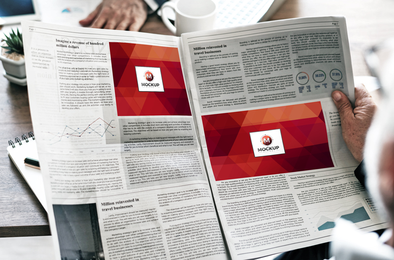 Free-Man-Reading-Multiple-Ads-Newspaper-Mockup-2018