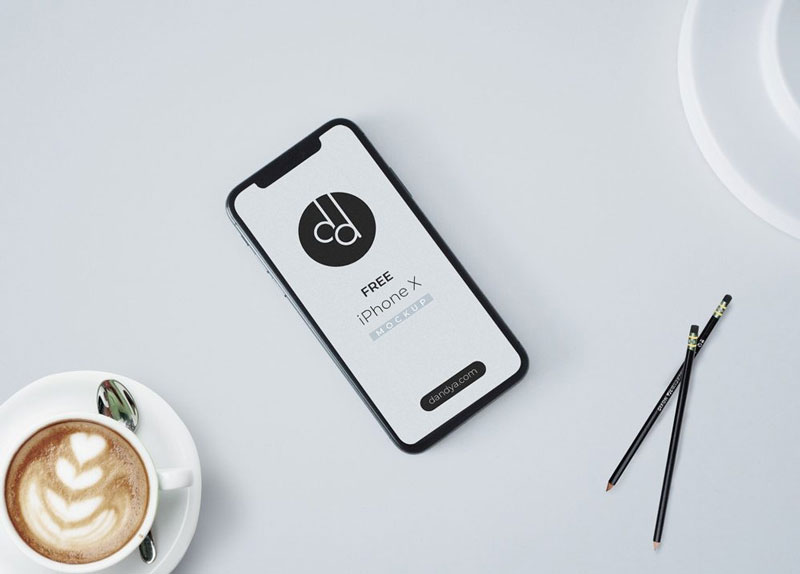 Free-iPhone-X-on-white-Table-Mockup-600