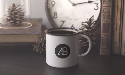 Free-Enamel-Mug-on-Wooden-Table-Mockup