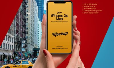 Free-Girl-Holding-Apple-iPhone-Xs-Max-Mockup-PSD-2018