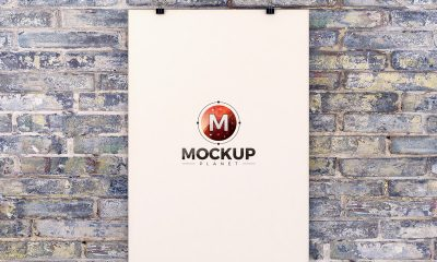 Free-Poster-Hanging-Over-Brick-Wall-Mockup-PSD