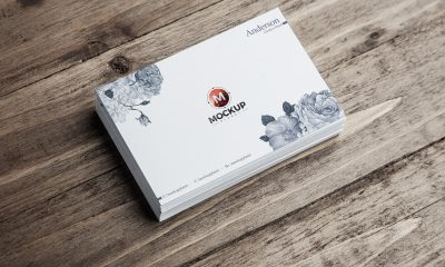 Free-Business-Cards-on-Wooden-Background-Mockup-PSD