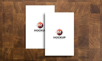 Free-Posters-on-Wooden-Background-Mockup-Design