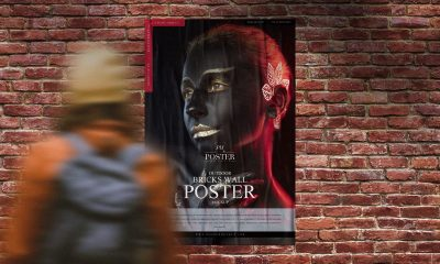 Free-Girl-Watching-Poster-on-Bricks-Wall-Mockup-Design