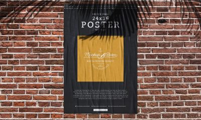 Free-Glued-Paper-on-Bricks-Wall-Poster-Mockup-Design