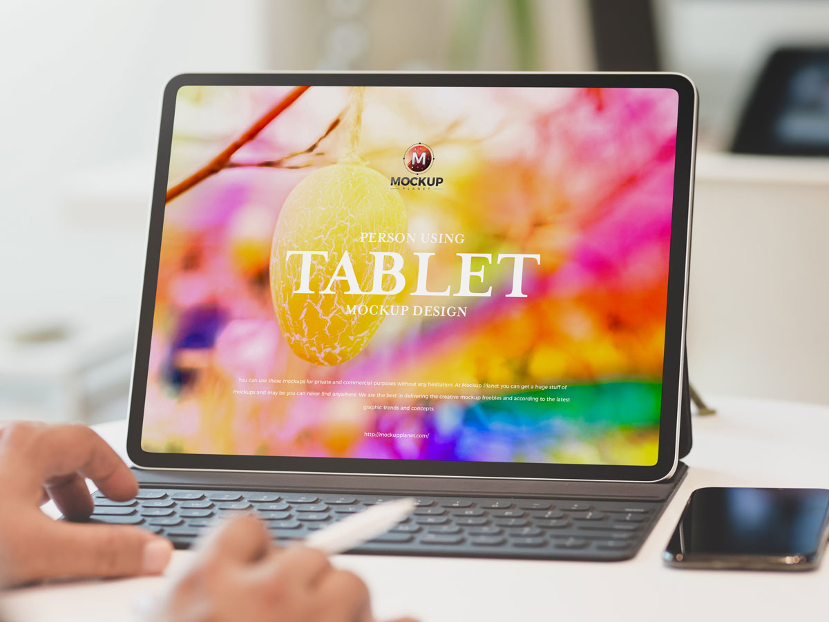Free-Person-Using-Tablet-Mockup-Design