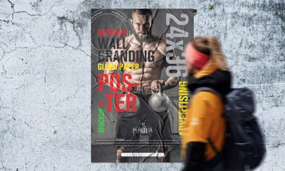 Free-Person-Looking-Wall-Poster-Mockup-Design
