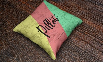Free-PSD-Square-Pillow-Mockup-on-Wooden-Background-2018