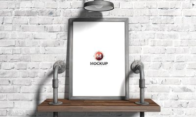 Free-Bricks-Wall-Wooden-Frame-Poster-Mockup-Design
