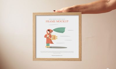 Free-Woman-Showing-Wooden-Square-Frame-Mockup-Design